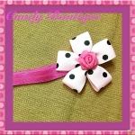 Băng đô hoa màu hồng chấm bi cho bé