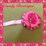 Băng đô hoa màu hồng có họa tiết cho bé