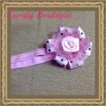 Băng đô hoa màu hồng phấn có họa tiết cho bé